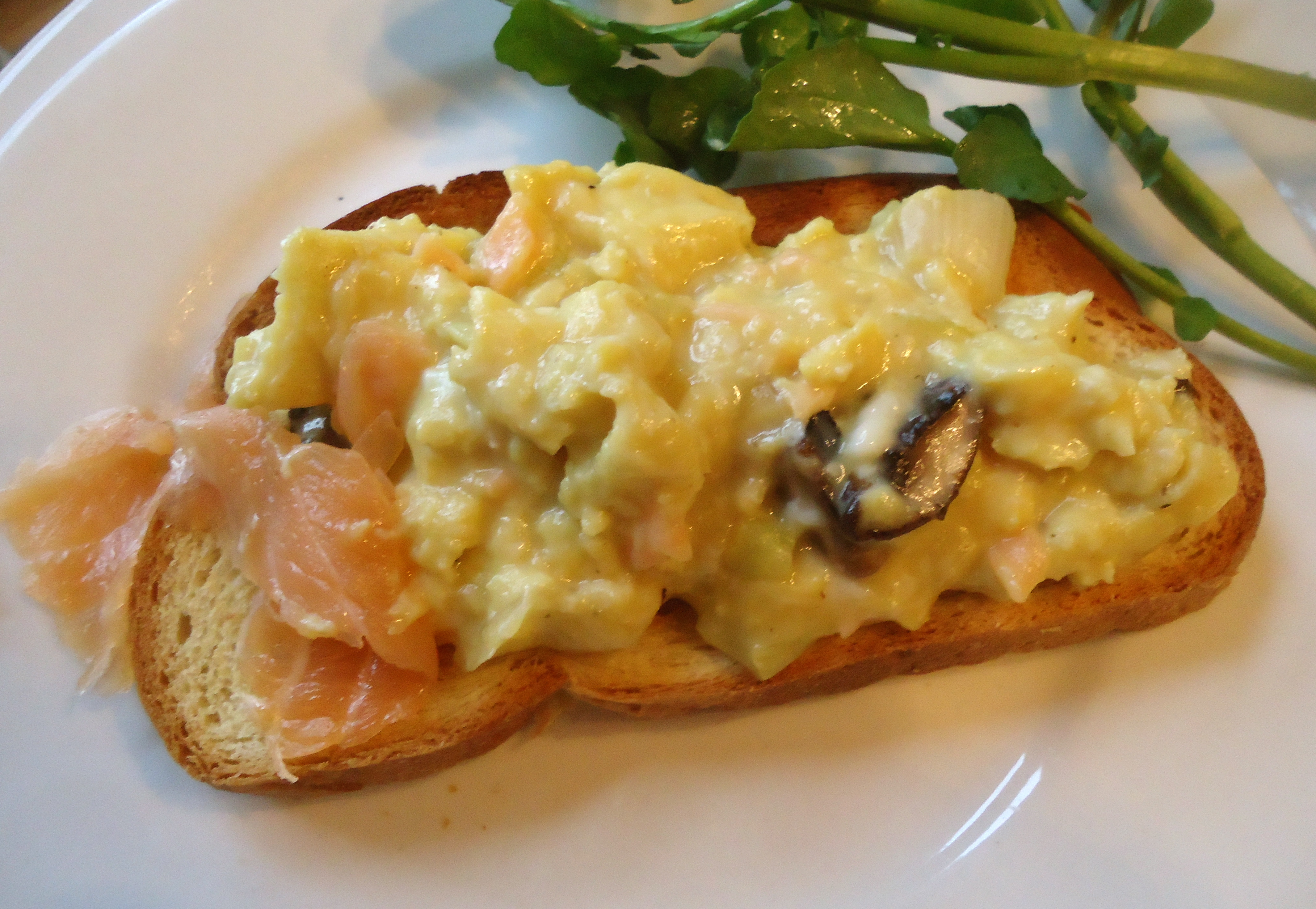 Breakfast With Creamy Scrambled Eggs Mushrooms And Smoked Salmon On
